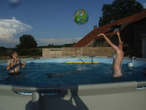 Benj, Ruadhri (submerged!) and Caitlin having holiday fun in the pool